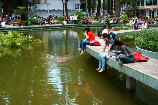 HO CHI MINH CITY, VIET NAM- OCT7: Lifestyle of young Asian people at urban, group of teenager sitting at Ho Con Rua to relax, talk with friend, fresh air in evening, amazing scene, Vietnam, Oct7, 2014