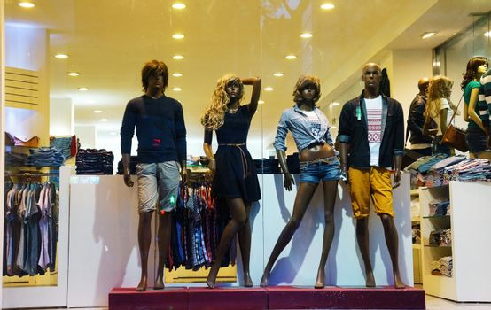 HO CHI MINH CITY, VIET NAM- OCT 5: Group of manequin wear fashion clothing, standing at window of dress retail mall, modern suit of garments market, Vietnam, Oct 5, 2014