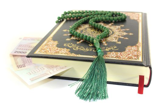 slammed Quran with Iranian currency