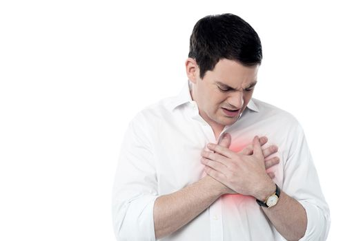 Young man having heart attack
