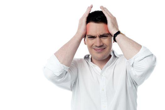 Stressed man having strong headache
