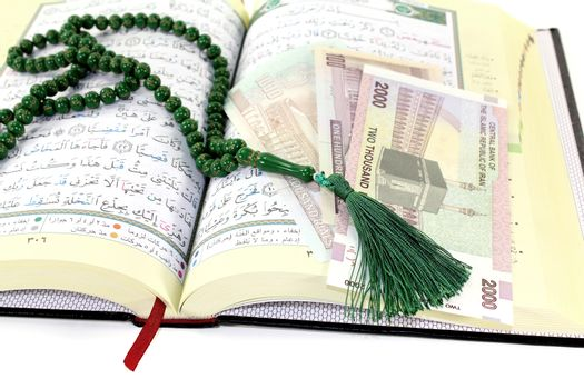 whipped Quran with Iranian Rials