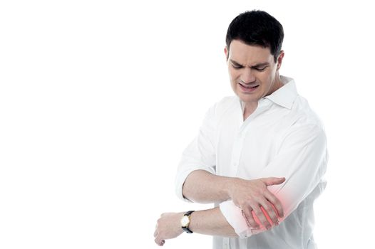 Man has pain in the elbow