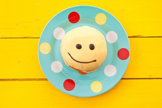 Donut with funny smiley face