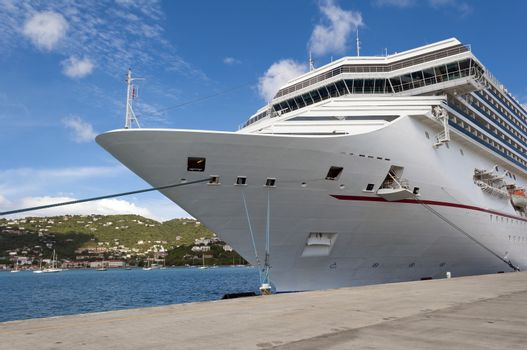 Cruise ship docked at a port in the Caribbean Sea.