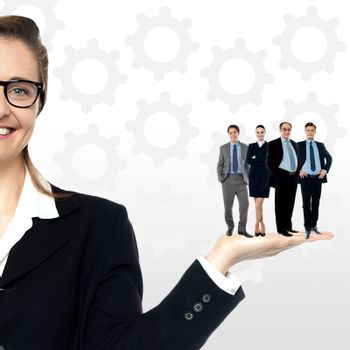 Business team standing together on woman's palm
