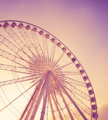 Ferris wheel with blue sky with retro effect