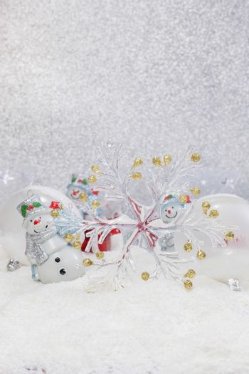 Cheerful snowman and Christmas tree decorations. Winter background. High key  with shallow depth of field