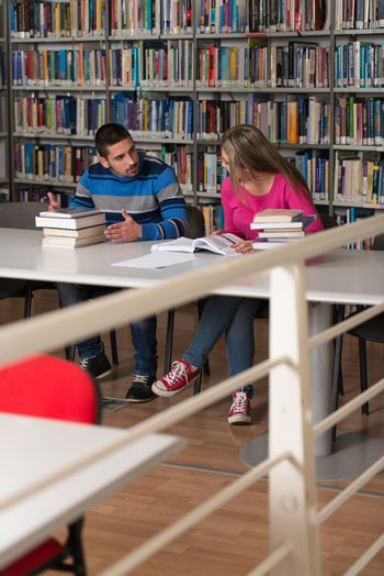 People Studying In A Library