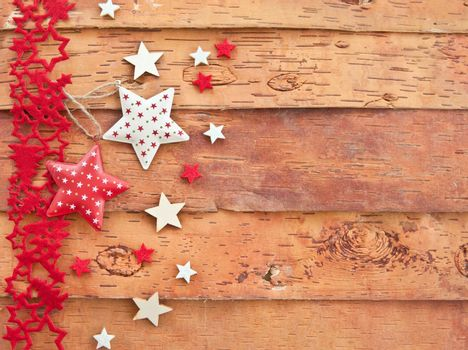 Wooden background with xmas decorations