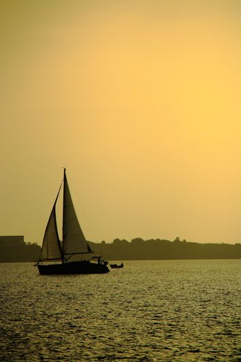 yachting at sunset on sea