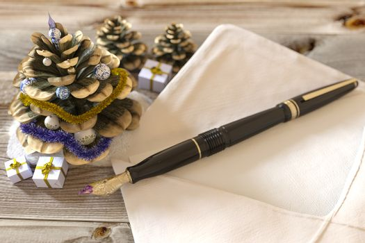 Christmas cone with gifts,pen and letter greetings holiday concept