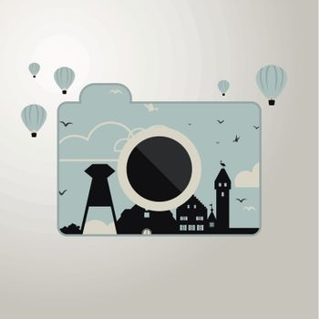 the camera with the image of the houses around balloons