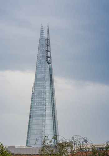 LONDON - SEPTEMBER 1 - The Shard skyscraper designed by Italian architect Renzo Piano has 87 storeys over a height of 1004 feet (306 metres) on September 1, 2013, in central London, UK.