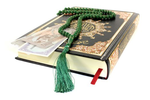 slammed Quran with Pakistani currency