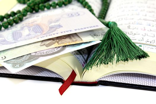 whipped Quran with Egyptian currency