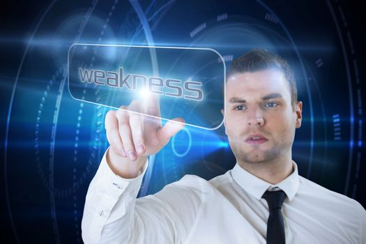 Businessman pointing to word weakness