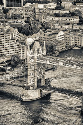 Aerial view of Tower Bridge and London skyline.