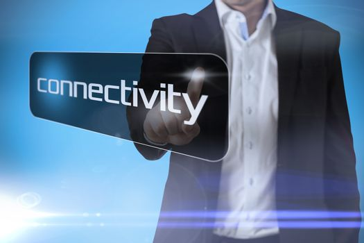 Businessman pointing to word connectivity