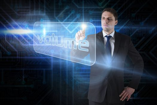 Businessman pointing to word volume
