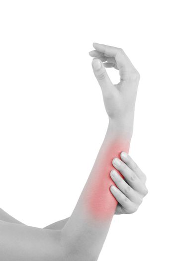 Forearm muscle strain. Female hand touching forearm with highlighted pain area isolated on white background.