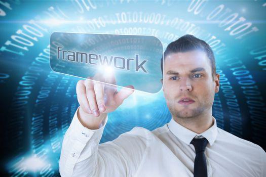 Businessman pointing to word framework