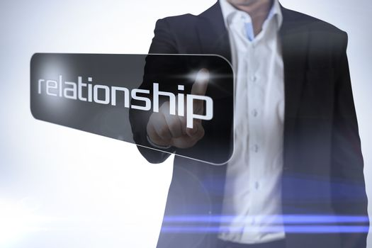Businessman pointing to word relationship