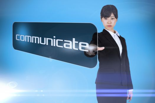 Businesswoman pointing to word communicate