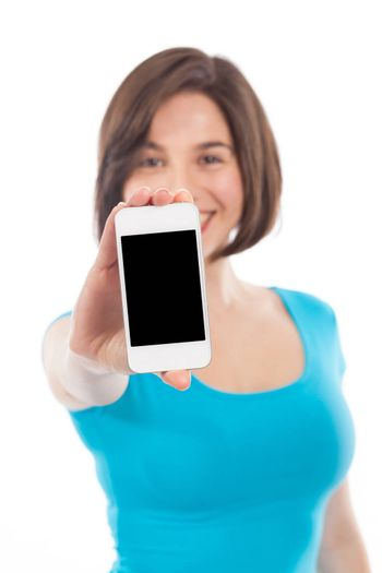 Young smiling woman showing a phone, communication concept, copy space, isolated on white