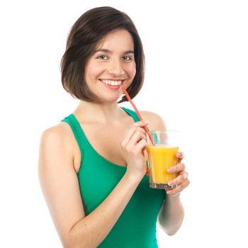 Portrait of a woman drinking an orange juice with a straw, isolated on white