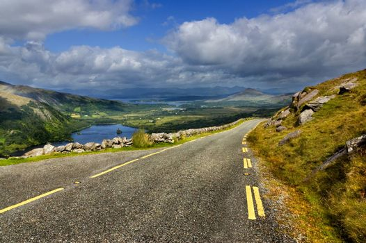 Mountain road with hills in background in Killarney National Park, Republic of Ireland