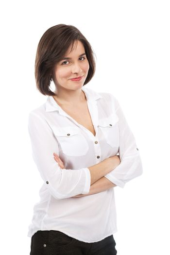 Portrait of a young brunette with her arms crossed, isolated on white