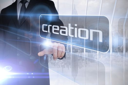 Businessman presenting the word creation
