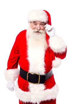 Santa Claus adjusting his spectacles