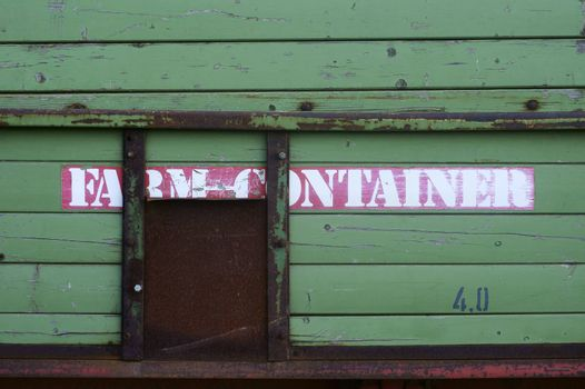 The close-up of an old rusted and nostalgic farm trailer.