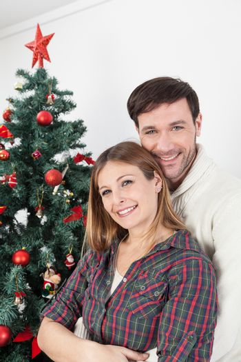 30-35, adult, background, ball, caucasian, celebrate, celebration, christmas, couple, cute, day, december, decorate, decorating, decoration, decorations, emotion, family, female, fun, gift, girl, green, happiness, happy, holiday, home, house, hug, husband, love, portrait,  lovers, male, man, marriage, men, model, new, old, person, present, property, red, relationship, releases, ribbon, romantic, santa, smile, star, together, tree, vertical, white, wife, winter, woman, women, xmas, year, years, young