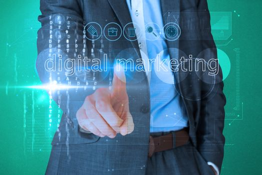 Businessman touching the words digital marketing on interface