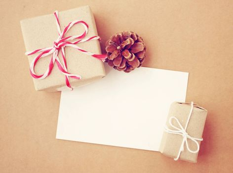 Handmade gift box and blank note paper with pine cone, retro filter effect