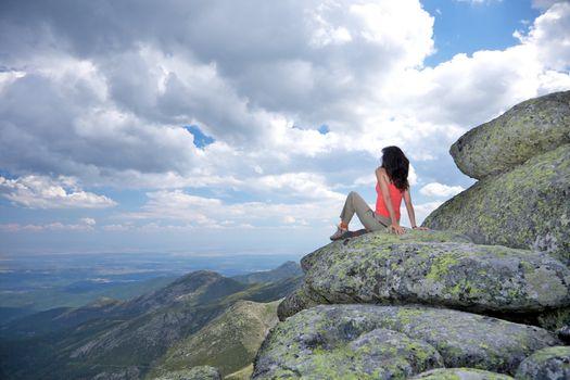 woman looking cloudscape