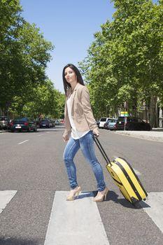 pulling suitcase on crosswalk