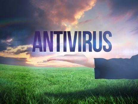 Businesswomans hand presenting the word antivirus