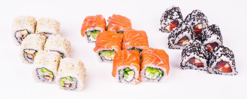 three sushi rolls isolated on white background