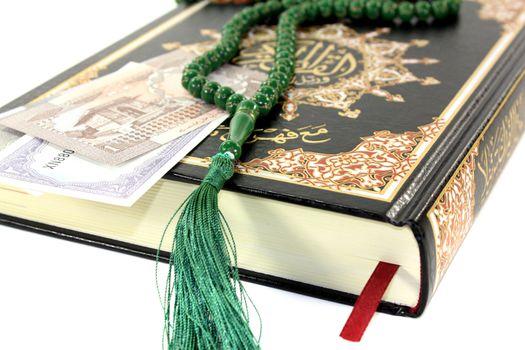 slammed Quran with Pakistani rupee