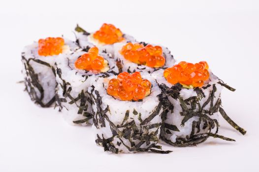 sushi roll in nori with caviar isolated on white background