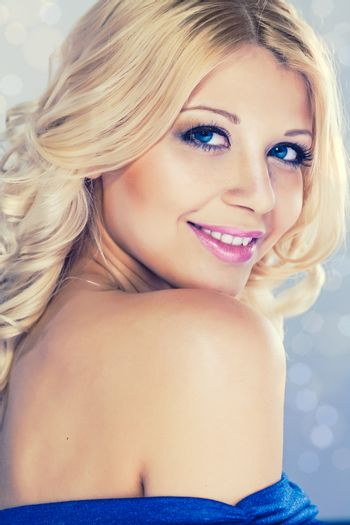 Portrait of young beautiful blond woman with fashion make-up and hairstyle