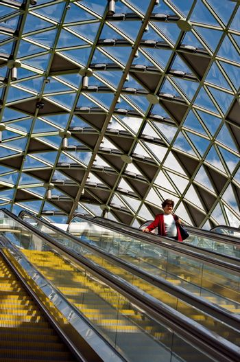 BUDAPEST, HUNGARY - AUGUST 17: Passengers passing by on the escalator  in Budapest, Hungary onAugust 17, 2014