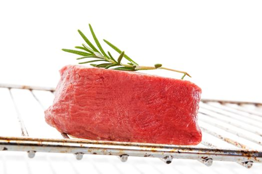 Raw steak on grill isolated.