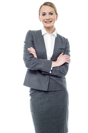 Confident business woman, crossed arms.