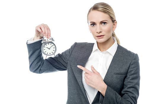 Boss pointing at alarm clock, you are late!