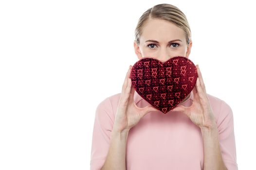 Woman holding gift box in form of heart